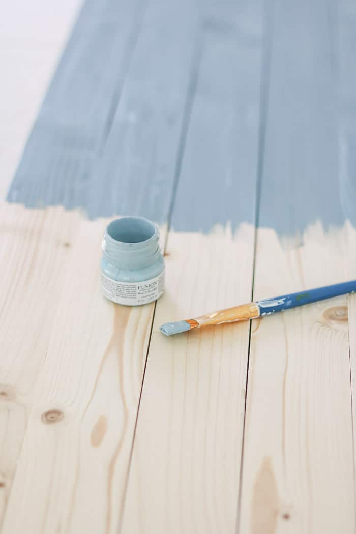 Painting the boards with Fusion mineral paint color champness to make a patriotic sign