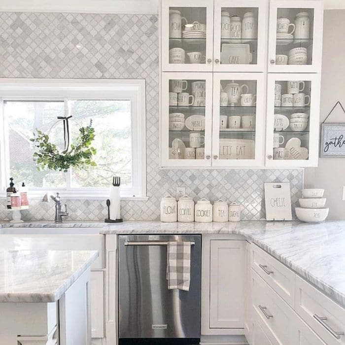 Farmhouse kitchen with glass doors by At Home With Jenna