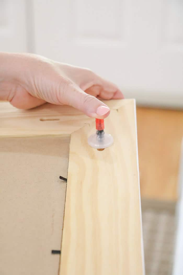Reapplying the cap to the marker on the StickyMark tool in a how to hang a gallery wall post.