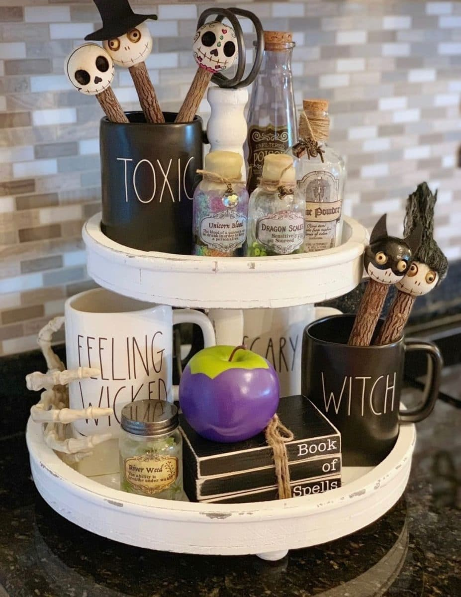 Halloween tiered tray ideas for home.  Rae Dunn mugs, poison jars, witches apple, wooden books, skeleton and more.