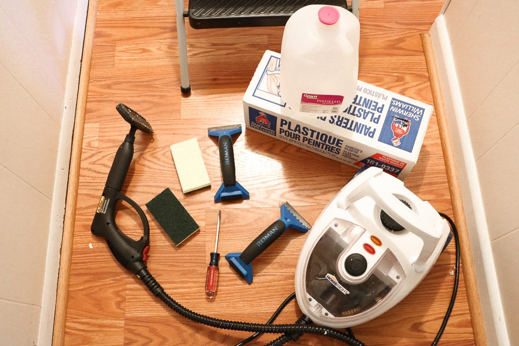 how to remove wallpaper with a steamer.  Removing old wallpaper with a Homeright steamer, plastic floor covering, distilled water, scrappers, sponges and screw driver
