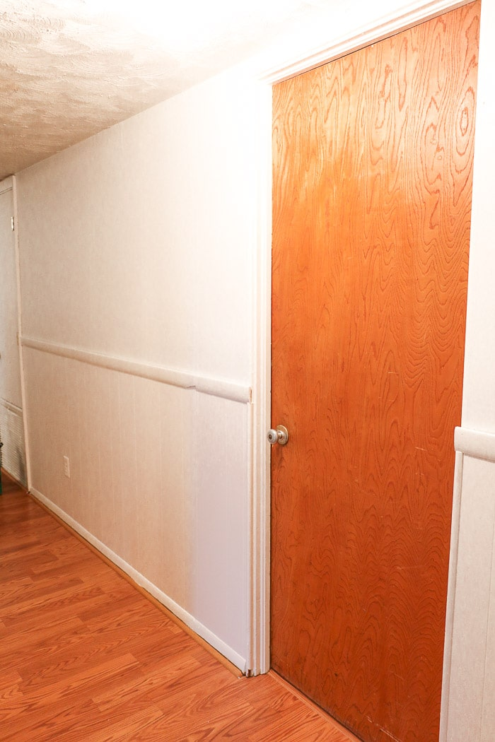 how to remove wallpaper with a steamer post and painting the walls Sherwin Williams alabaster white in the hallway.