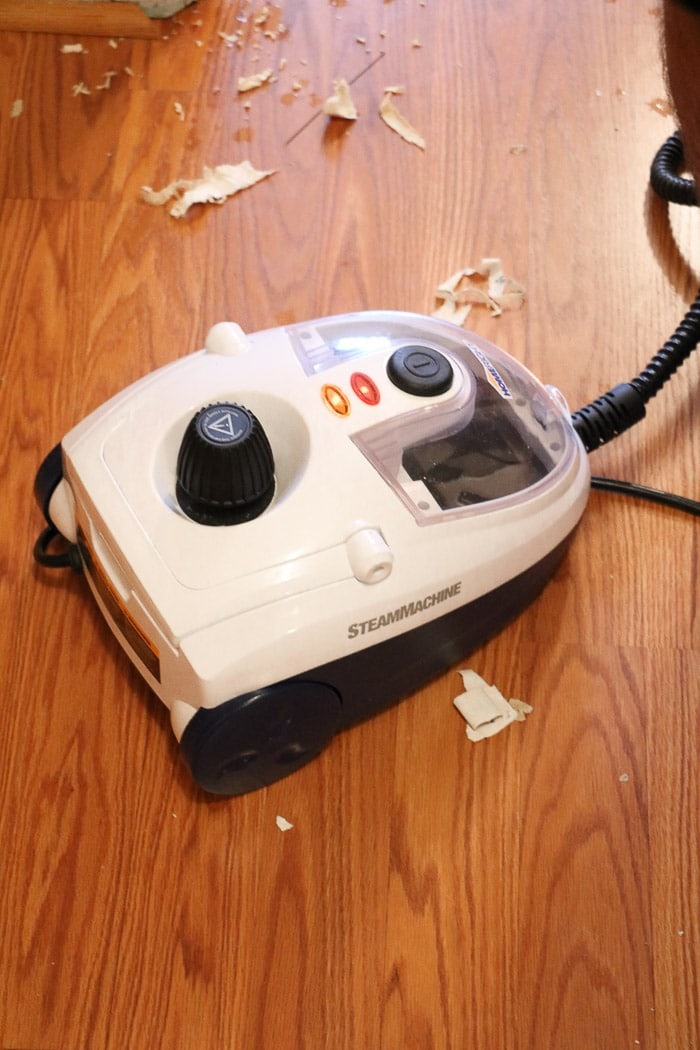 how to remove wallpaper with a steamer.  Removing old wallpaper with a Homeright steamer