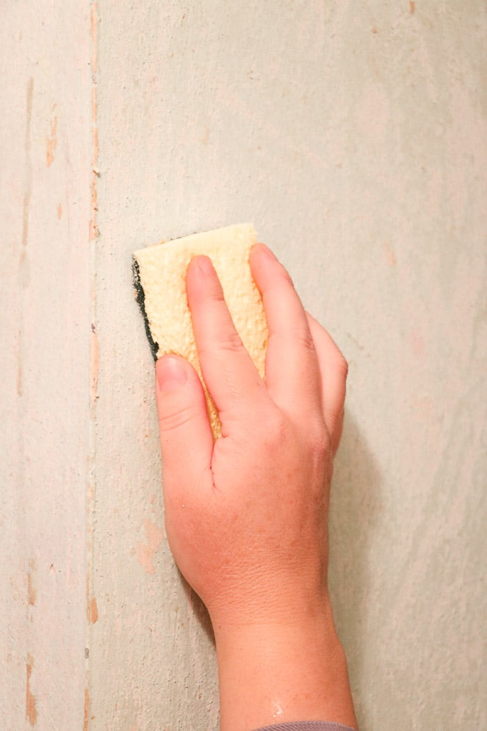 how to remove wallpaper with a steamer.  Removing old wallpaper with a Homeright steamer in a small hallway and scrubbing any residue from the wall with a scrub sponge.
