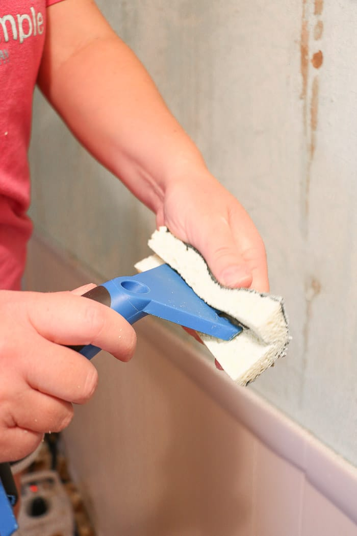 how to remove wallpaper with a steamer.  Removing old wallpaper with a Homeright steamer in a small hallway and scrapping away the old wallpaper and cleaning the scrapper as we go.
