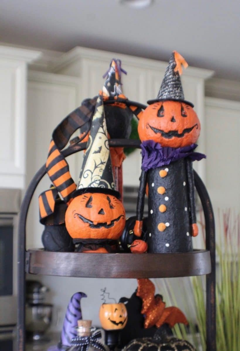 Halloween tiered tray ideas for home.  Jack o'lantern people with magician hats on a three tiered tray.