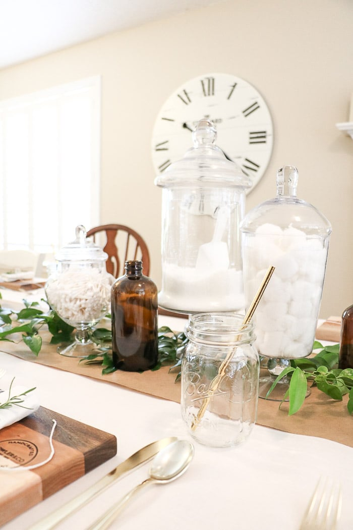 Nurses graduation party ideas that are casual and elegant.  A DIY sharing easy tips and trick for creating a vintage style medicinal apothecary centerpiece on a dining table.