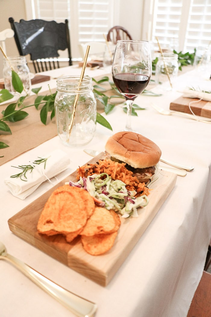 Sharing recipes from Eat Picks for our nurses graduation party ideas.  BBQ slider sandwiches, potato pancakes made with sweet potatoes, coleslaw and chips.  And all served on a cutting board.