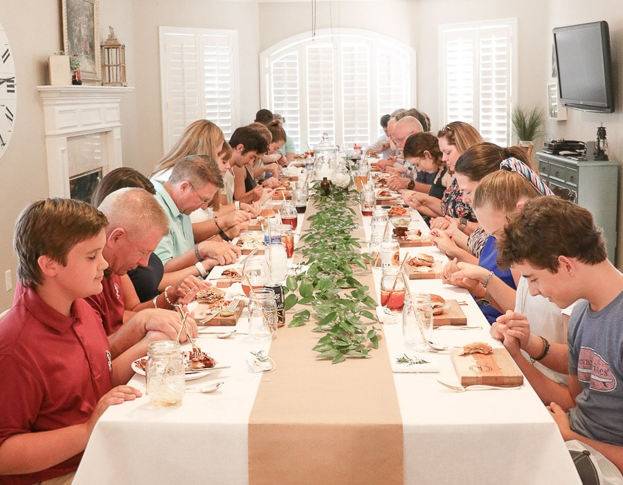 Sharing nursing graduation party ideas that are easy and inexpensive.  This photo is a memorable moment where all my family gathered at one table to thank the Lord for helping my daughter graduation nursing school and saying grace for the food.  This was an iconic photo that reminded me of Norman Rockwells freedom from want photo.