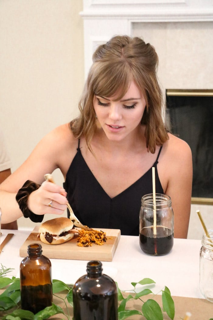 Sharing nurses graduation party ideas for an elegant but casual event.  Serving bbq slider sandwiches on a cutting board and using a Ball mason jar for beverages.  My daughter, the graduating nurse enjoying the celebration,