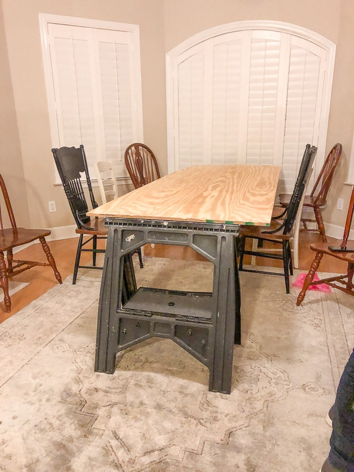 """Nurses graduation party ideas including a temporary table made from sawhorses and 1/2"""" plywood."""