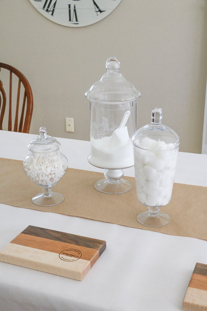 Nurses graduation party ideas using medicinal vintage apothecary jars as the centerpiece.  Fill the jars with doctors office items like cotton balls and epson salt.  Place the jars staggered like in this photo or in a straight row.