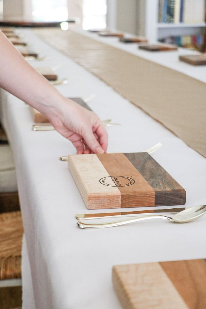 Nurses graduation party ideas.  Place cutting boards at each place setting as plates for the guest along with gold plastic silverware.