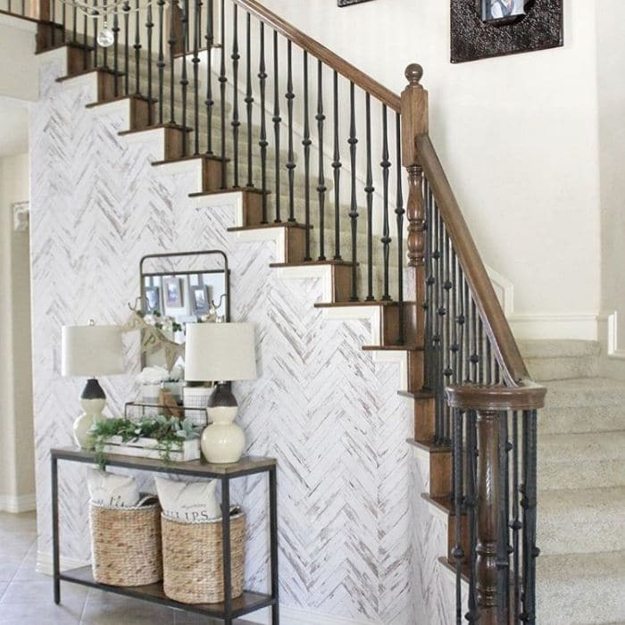 Farmhouse Style Wallpaper by Table for 5 Please with a herringbone patterned wallpaper on her staircase