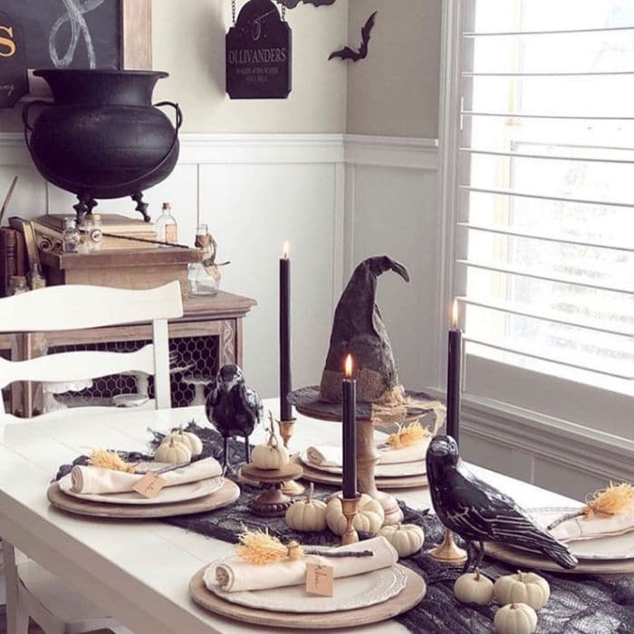 Halloween Table Decorations by Sweet Rose & Wren with a Halloween table complete with pumkins, witches brooms, crows and a witch hat