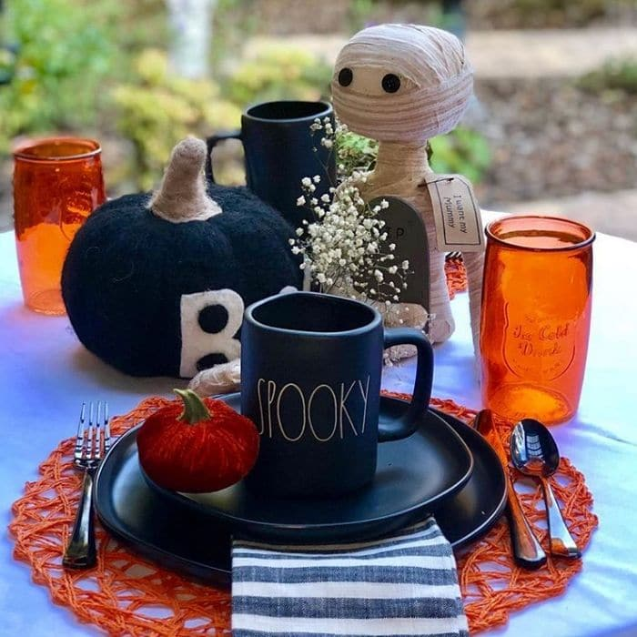 Halloween Table Decorations by 13 Tables with Rae Dunn Spooky mugs, pumpkins, mummies and more black and orange pieces