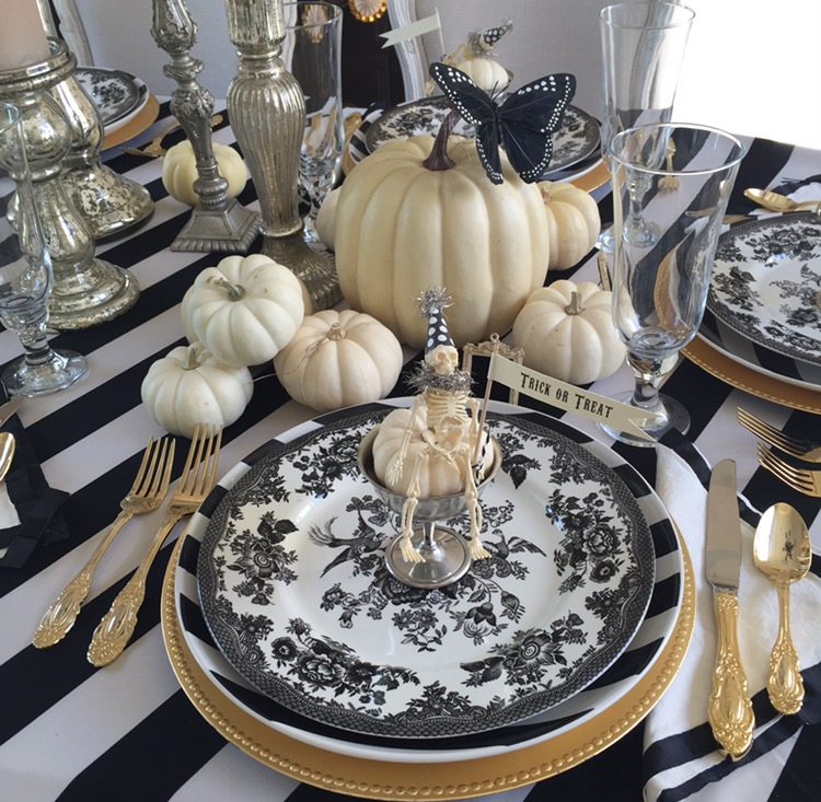 Halloween Table Decorations by Randi Garrett Design with a black, white and gold elegant Halloween table setting