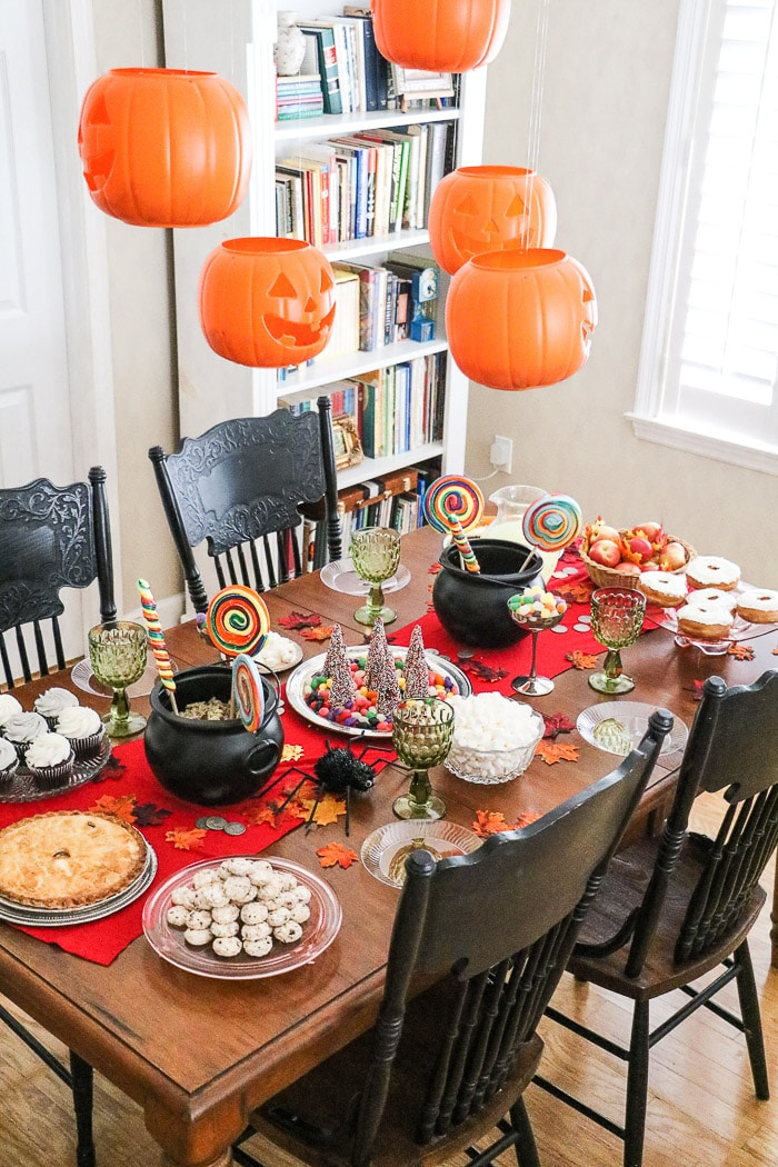 Harry Potter table decorations using floating jack o lanterns and loads of baked good and candy.