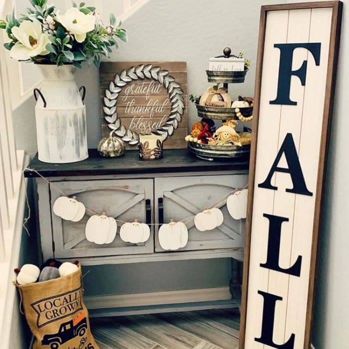 Fall Home Decor by Honeybee Philosophy with a farmhouse fall filled nook, complete with a shiplap fall sign, pumpkin garland and a locally grown burlap pumpkin bag