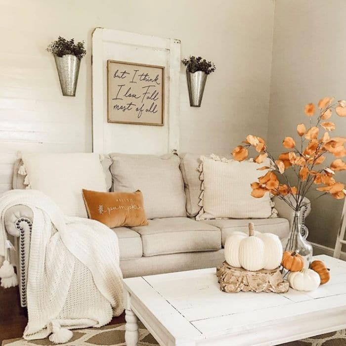 Fall Home Decor by The Finley Farmhouse with golden fall hughes in her living room
