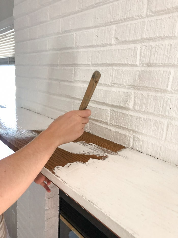 How to paint fireplace bricks.  Paint the mantle with the same primer paint combo like the Behr Marquee paint.
