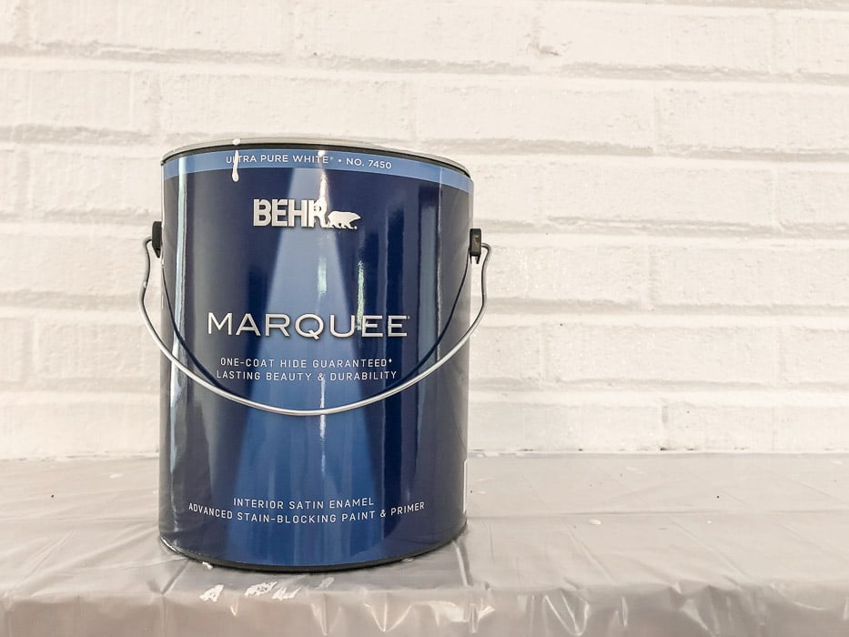 How to paint fireplace bricks.  Use a quality primer and paint combo like this one from Behr called Marquee