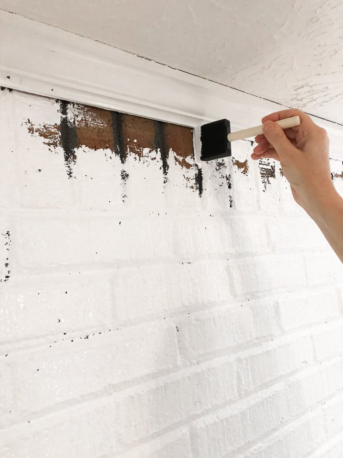 How to paint fireplace bricks.  Filling in the mortar joins with paint.