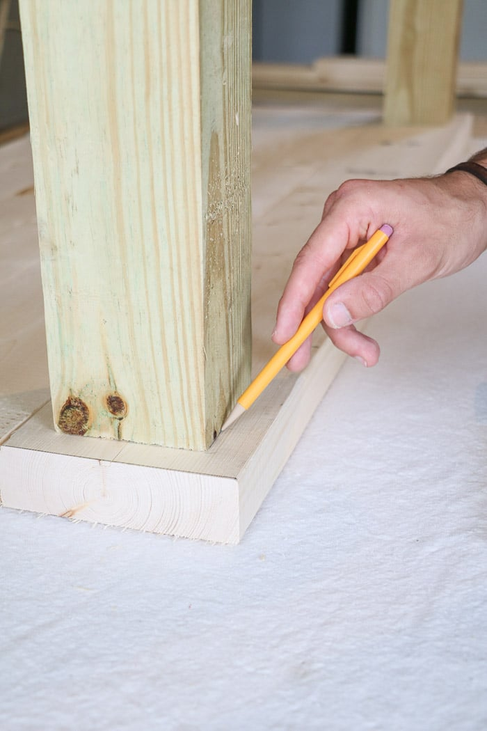 How to build a farmhouse table. Draw a line around the legs.