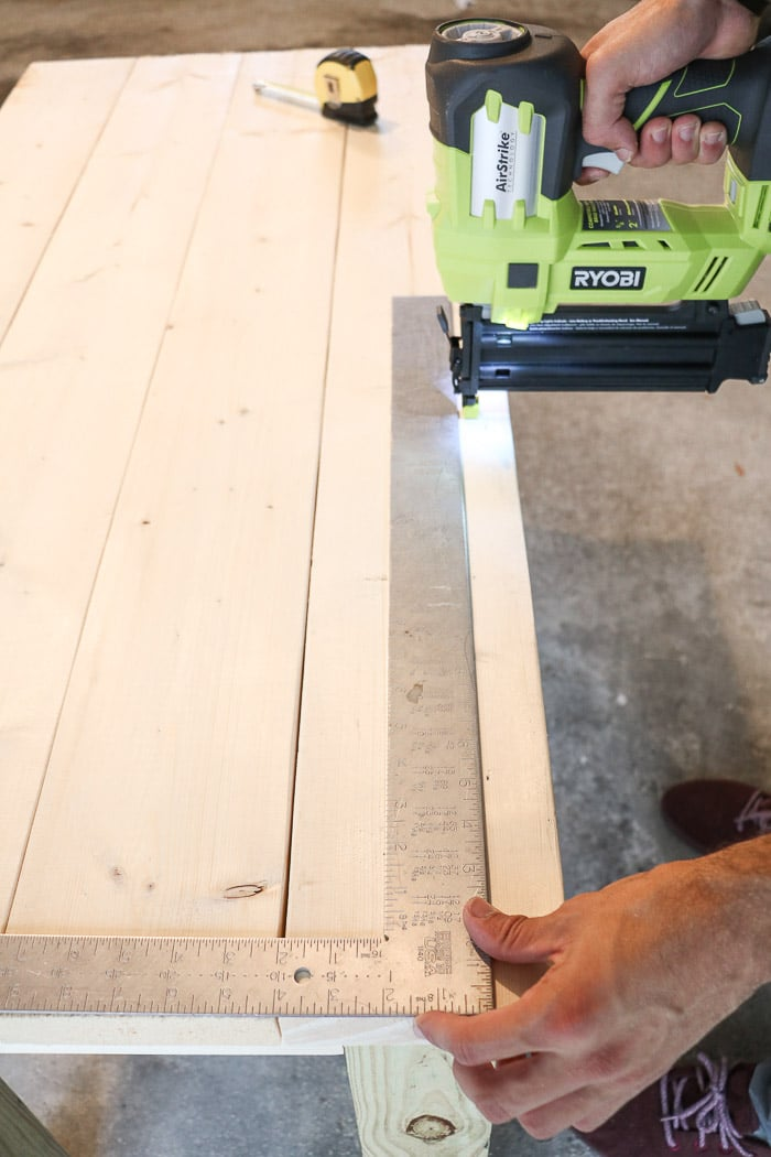 How to build a farmhouse table. Nail top boards to apron.