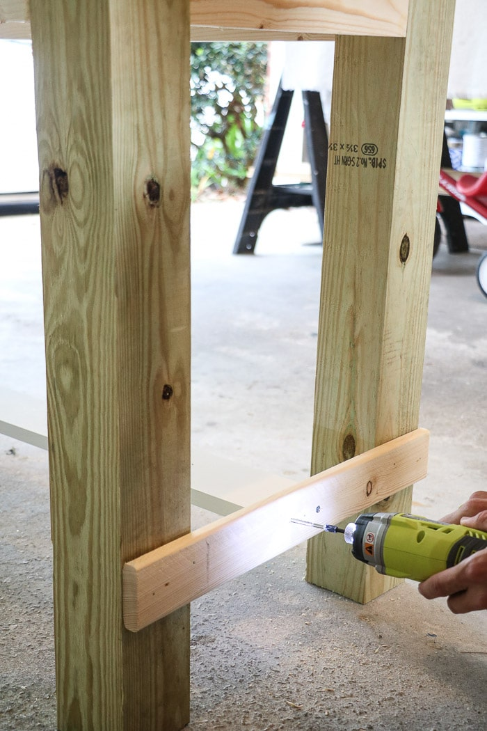 How to build a farmhouse table. Screw in center board to brace.