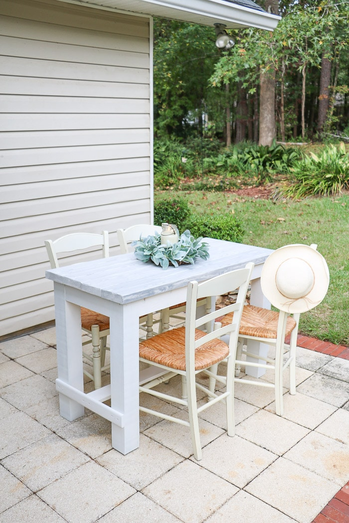 How to build a farmhouse table. Table finished in white with a grew weather wood grain faux finish top.