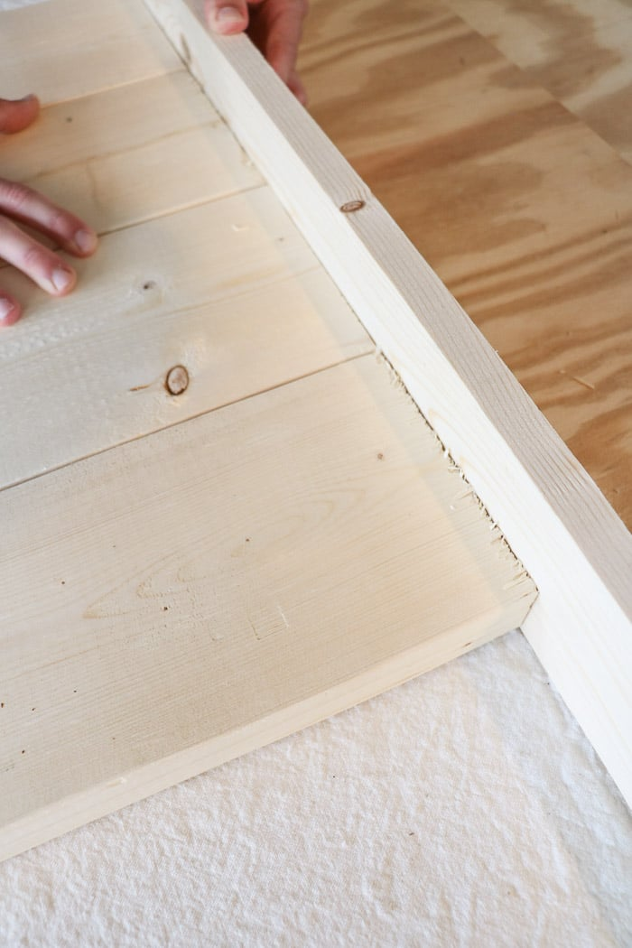 how to build a farmhouse table.  Line up the boards.