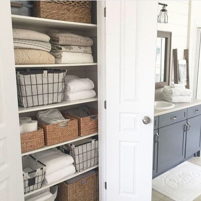 How To Decorate With Baskets with bathroom organizing with baskets by Willow Bloom Home Blog