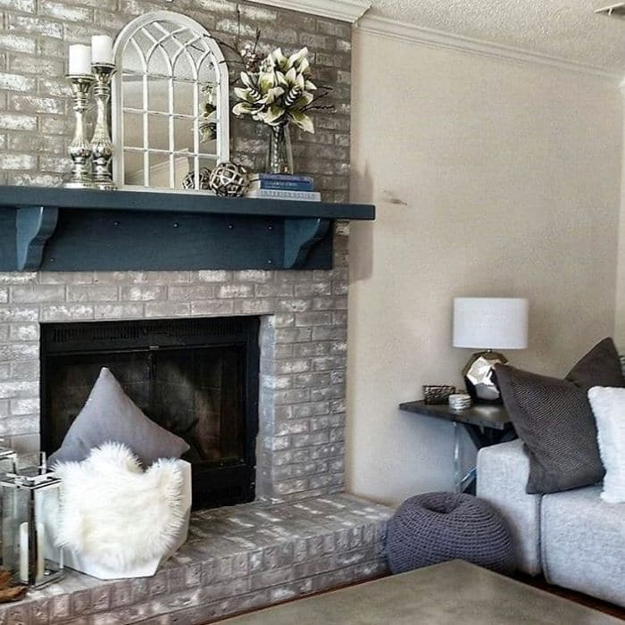 Fireplace Makeovers by Decorate And More With Tip with a taupe and white painted fireplace