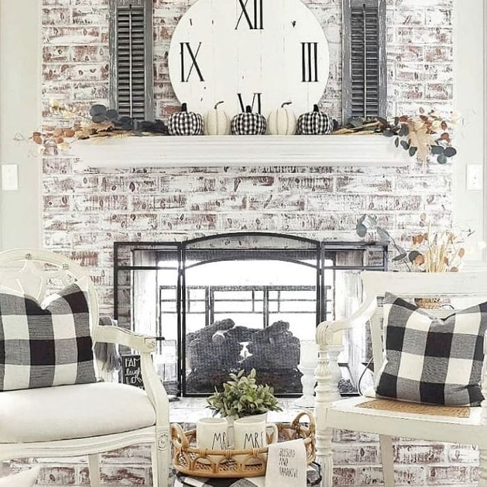 Fireplace Makeovers by DIY Beautify with a chalk paint makeover on a fireplace