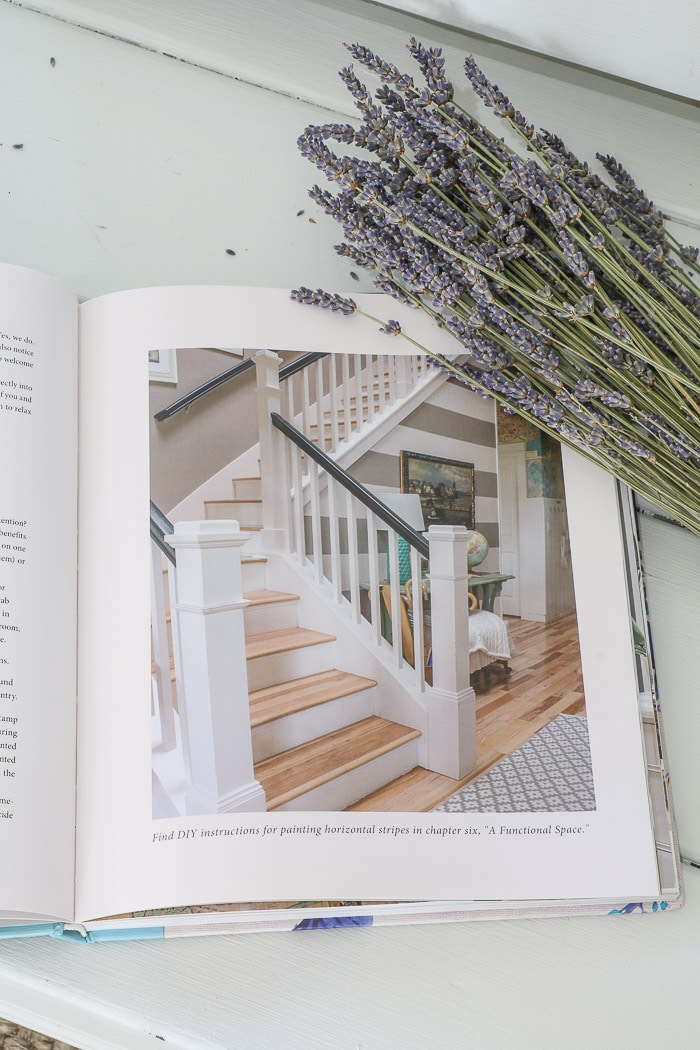 Inside of The Inspired Room by Melissa Michaels.  Dried lavender sitting on the corner of this best interior design book for beginners.