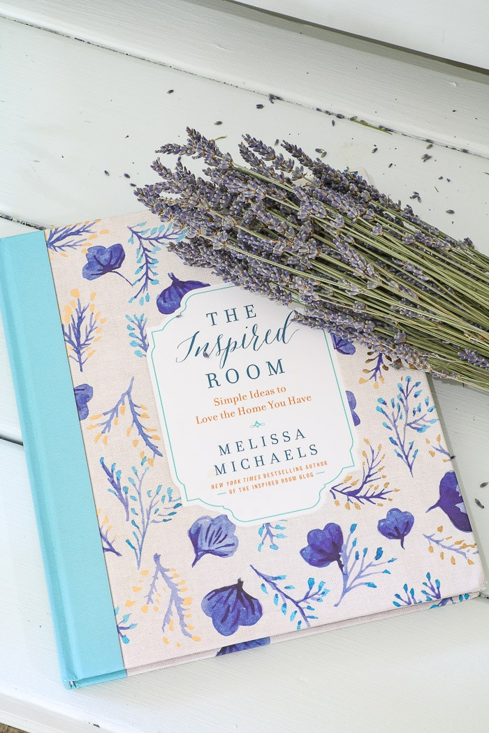 The Inspired Room by Melissa Michaels.  A beautiful coffee table book with dried lavender.  One of the best interior design books for beginners.