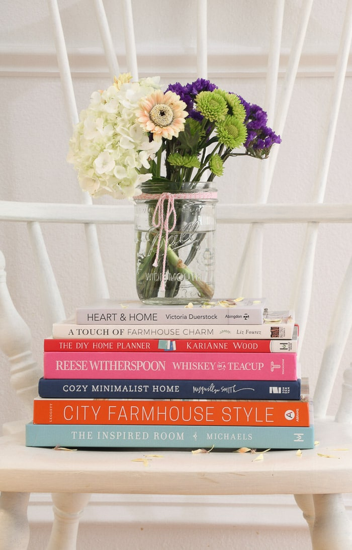 7 best interior design books for beginners.  Heart and Home, A Touch of Farmhouse Charm, The DIY Home Planner, Whiskey in a Teacup, Cozy Minimalist Home, City Farmhosue Style, The Inspired Room.