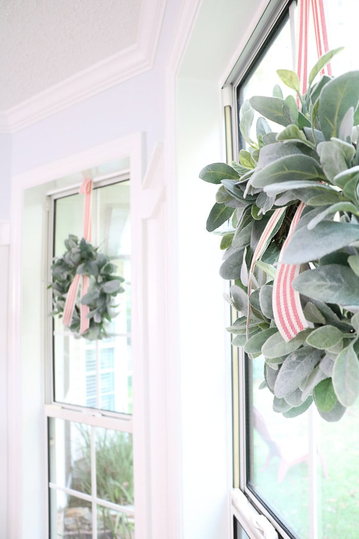 How to hang a wreath with ribbon on a window.  This simple DIY will show you two ways to hang wreaths on windows inside your home.
