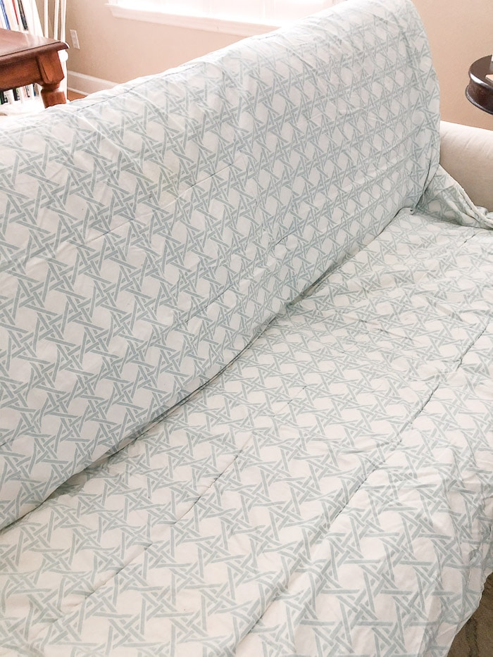 How to wash Ikea slipcovers.  Place the cushions back on the sofa and cover it with a comforter and blanket.