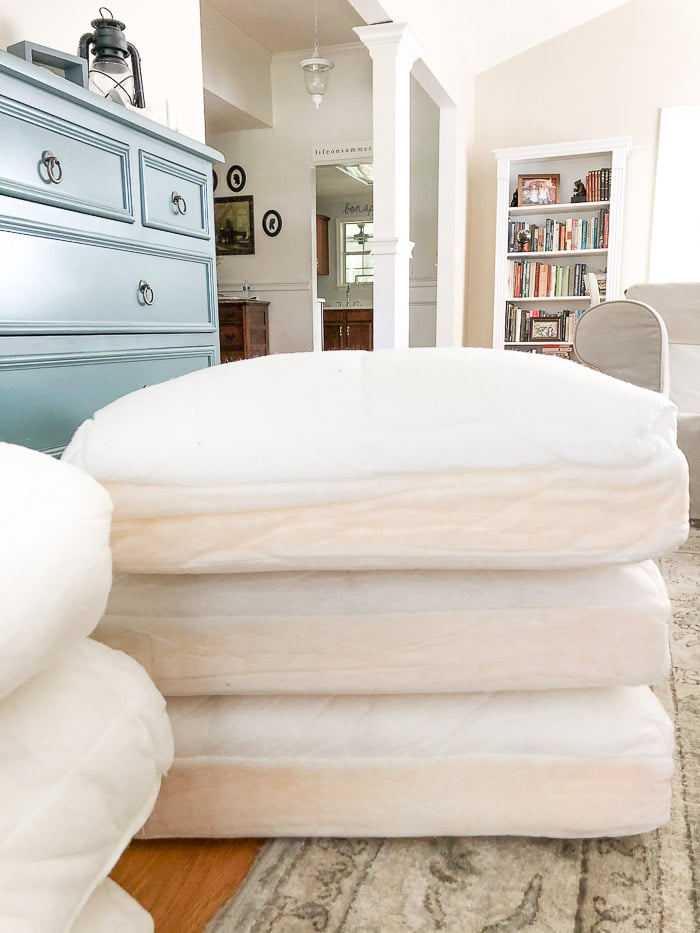 How to wash Ikea slipcovers.  Remove the slipcover from the cushions.