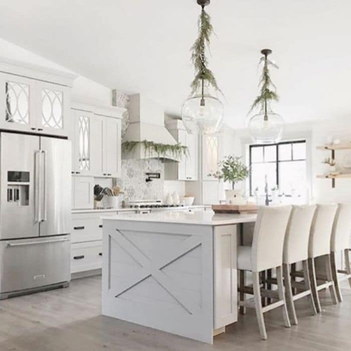 Christmas Kitchen Decor by Farm Fresh Curls with greenery hanging in the kitchen