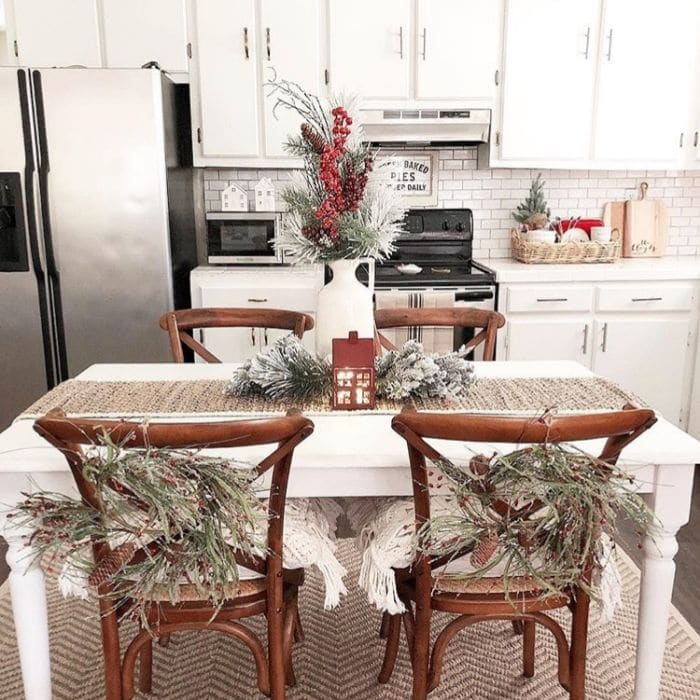 Christmas Kitchen Decor by Angela Hodges Abode with wreaths hanging on chairs at Christmas time