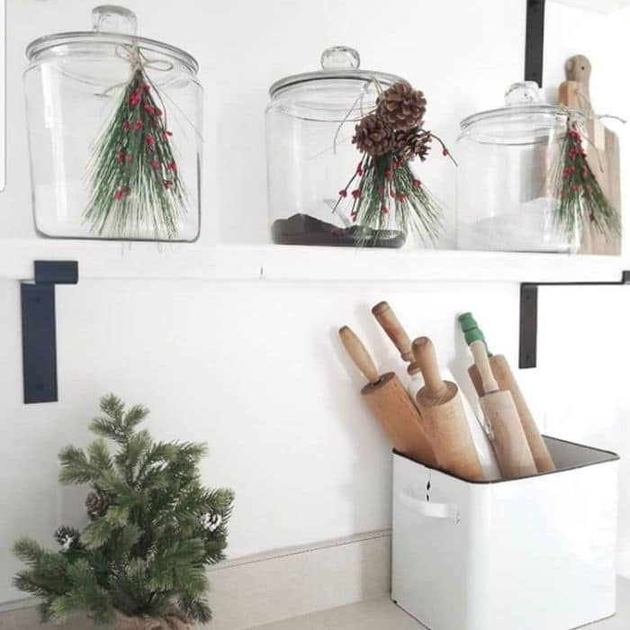 Christmas Kitchen Decor by Rusty 7's with greenery, holly and pine cones hanging on jars