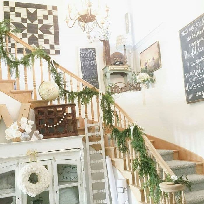 Decorating With Barn Quilt by Tweetle Dee Design Co with a barn quilt on a flight of stairs