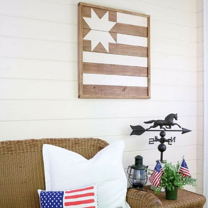 Decorating With Barn Quilts with a barn quilt hanging on the porch