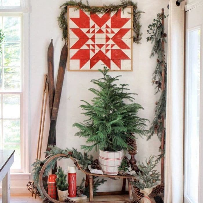 Decorating With Barn Quilts by Baker Nest with a barn quilt hanging in a corner with Christmas decor