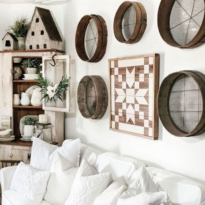 Decorating With Barn Quilts by Down Shiloh Road with a barn quilt hanging above a sofa