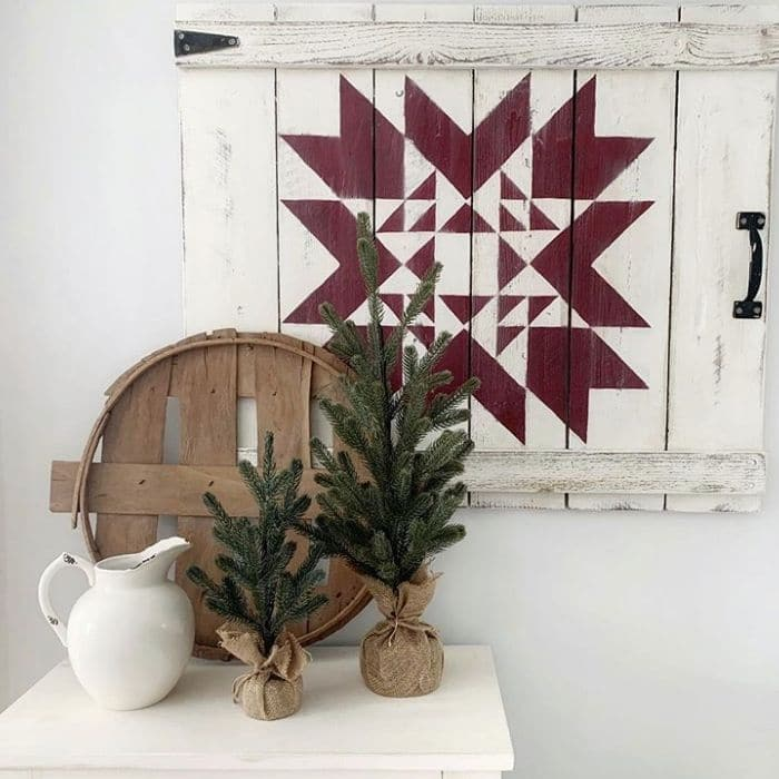 Decorating With Barn Quilts by The French Farmhouse with a Christmas vignette including a barn quilt