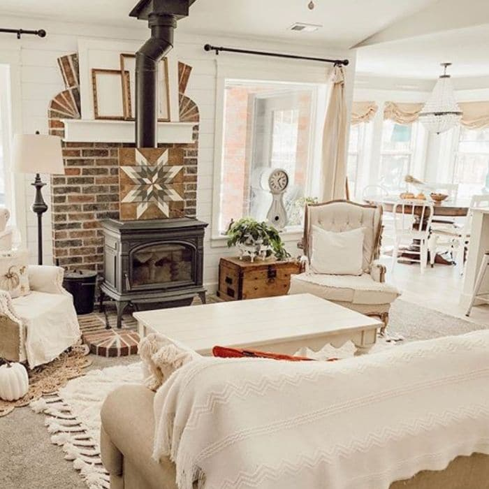 Decorating With Barn Quilts by Sage Hill Cottage with a barn quilt setting atop a fireplace
